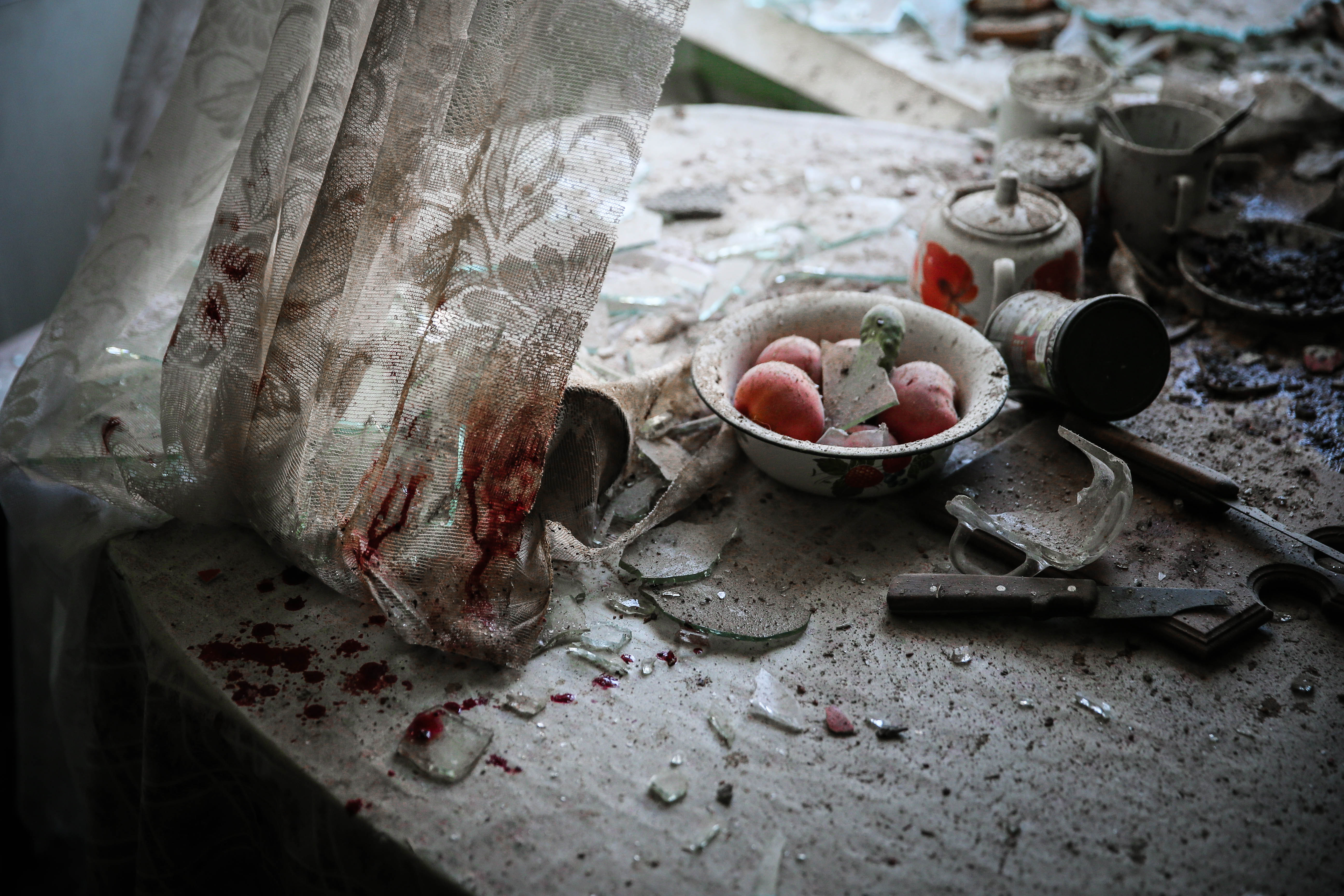 Damaged goods lie in a damaged kitchen in downtown Donetsk, Ukraine, 26 August 2014. Residential areas in several districts of Donetsk, including the central part of the city, suffered from artillery fire, three people was killed and 10 wounded, the press centre of Donetsk city Council reported.